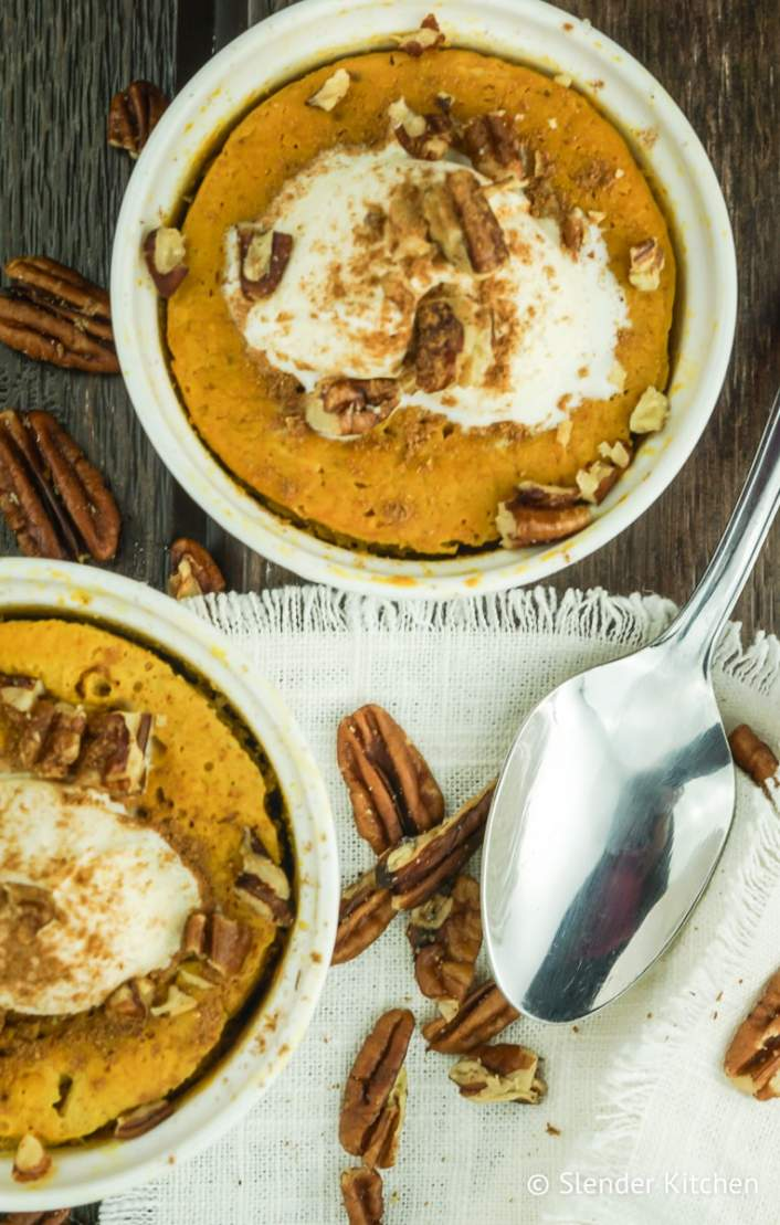Microwave Pumpkin Custard with pecans and whipped cream.