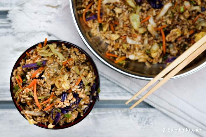 Healthy fried rice with vegetables in bowls.