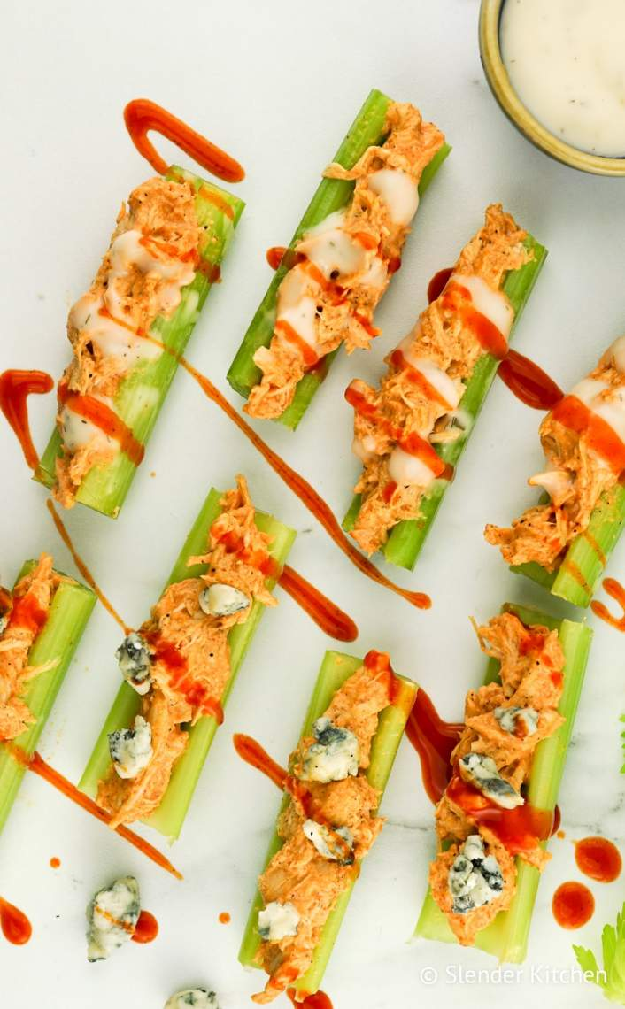 Low Carb Buffalo Chicken Celery Bites with celery and ranch dressing.